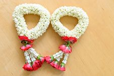 Pair Of Thai Style Garland On Wood Background Stock Images