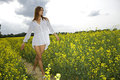 Free Brunette Woman In A Yellow Flowers Field Royalty Free Stock Photos - 24486998