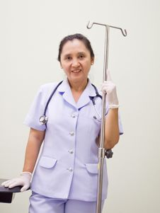 Free Nurse With I.V Drips Equipment Stock Image - 24480161