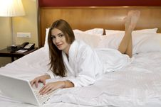 Free Portrait Of Beautiful Woman With Laptop On Bed Stock Photos - 24486873