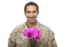 Free Hispanic Military Man With Pink Flowers Royalty Free Stock Photo - 24492635