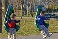 Free Boys Swinging Royalty Free Stock Image - 2458616
