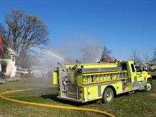 Free Yellow Firetruck, Rainbow Mist Royalty Free Stock Photos - 2450138