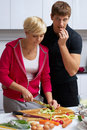 Free Lovely Couple Making A Salad Royalty Free Stock Image - 24508036