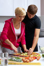 Free Lovely Couple Making A Salad Royalty Free Stock Image - 24508056