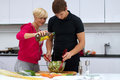 Free Lovely Couple Making A Salad Stock Photography - 24508122
