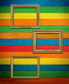 Gold Frame On Colorful Wood Royalty Free Stock Image