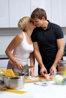 Free Couple In Their Kitchen Making Dinner Stock Photo - 24507740