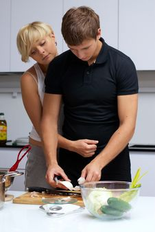 Free Couple In Their Kitchen Making Dinner Stock Images - 24507774