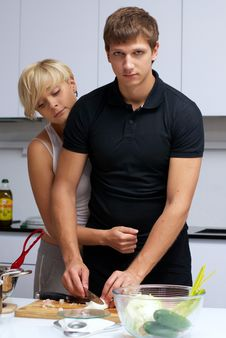 Free Couple In Their Kitchen Making Dinner Stock Images - 24507814