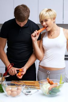 Free Couple In Their Kitchen Making Dinner Royalty Free Stock Image - 24507836