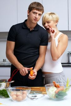 Free Couple In Their Kitchen Making Dinner Stock Image - 24507851