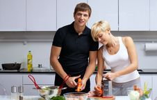 Free Couple In Their Kitchen Making Dinner Stock Image - 24507891