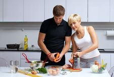 Free Couple In Their Kitchen Making Dinner Royalty Free Stock Photo - 24507915