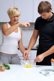 Free Couple In Their Kitchen Making Dinner Royalty Free Stock Image - 24507956