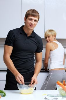 Free Couple In Their Kitchen Making Dinner Stock Photography - 24507972