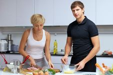 Free Couple In Their Kitchen Making Dinner Stock Image - 24507991