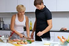 Free Couple In Their Kitchen Making Dinner Royalty Free Stock Photography - 24508017