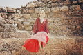 Free Girl In Red Sitting On The Wall Royalty Free Stock Photos - 24510658