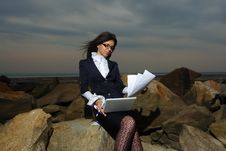 Business Lady Sitting On The Rocks By The Sea, Aga Stock Image