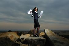 Business Ladies Standing On Rocks By The Sea, Agai Stock Photos