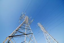 Free Two Electrical Pylons On Blue Sky Royalty Free Stock Image - 24528186