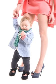 Free Baby Girl Near Her Mother S Legs Royalty Free Stock Photo - 24535285