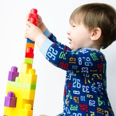 Free Small Boy Builds Tower Stock Photos - 24538073