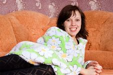 Girl Lying On The Sofa At Home Royalty Free Stock Images