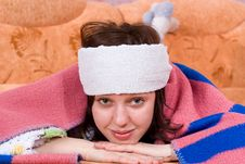 Free Girl Is Sick And Lying On The Sofa Stock Images - 24539344
