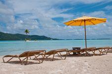 Chairs And Umbrella On The Beach In Bora Bora Royalty Free Stock Photos