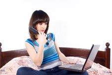 Free Girl On The Bed For A Laptop Royalty Free Stock Photos - 24541368