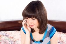 Free Girl Talking On The Phone While Sitting On The Bed Stock Photo - 24541580