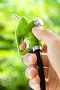 Free Hand Holding Eco Fuel Nozzle Stock Image - 24551041