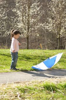 Free Small Child Playing With An Umbrella Stock Images - 24550564