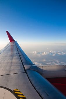 Wing Of An Airplane With A View Over The Clouds Royalty Free Stock Photography