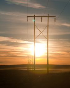 Power Lines Lead Into The Sunset Stock Images