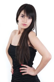 Beautiful Brunette In A Black Dres With Long Hair Royalty Free Stock Images