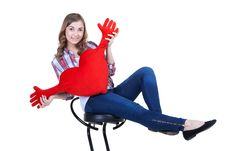 Beautiful Girl With A Red Plush Heart Stock Images