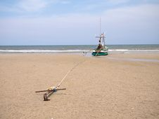 Free A Fishing Boat Anchored By The Beach Stock Image - 24586381
