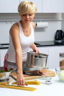 Pretty Blond Girl In The Kitchen Making Pasta Stock Photography