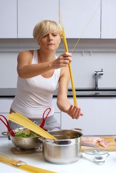 Pretty Blond Girl In The Kitchen Making Pasta Stock Images