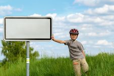 Free Boy Cyclist Leaning On Blank Sign Stock Photos - 24589513