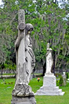 Free Statues And Crosses At A Cemetery Royalty Free Stock Photo - 24597545