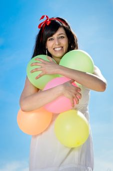 Hugging Colorful Balloons Stock Photos