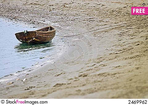 Free Beached Wooden Row Boat Stock Photography - 2469962