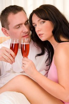Free Couple In Bed Drinking Wine Royalty Free Stock Photo - 2461525