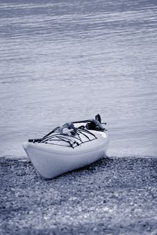 Free Lone Kayak Needs A Paddle Stock Image - 2465541