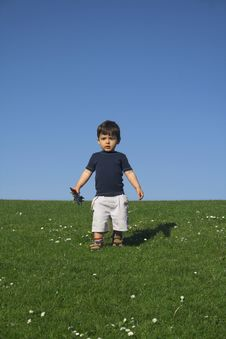 Free Child Standing In Field Royalty Free Stock Photos - 2467368