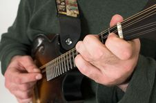 Free Man Playing Guitare Close Up Royalty Free Stock Image - 2467446